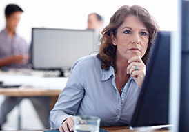 Woman in an office using a computer