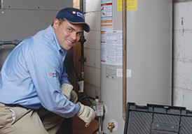 PSE&G technician servicing a hot water heater