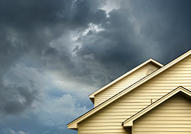 Stormy skies behind house roof