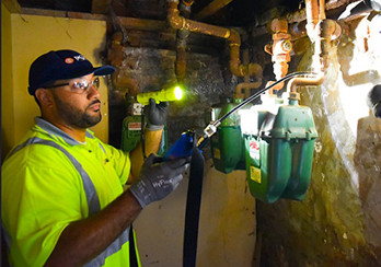 a PSE&G technician working on gas lines in a basement