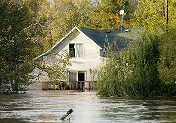Floodwaters rising up to 2nd floor of a house