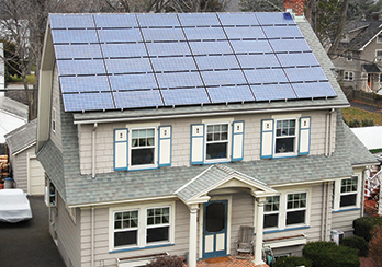 Two-story suburban home with solar panels on the roof