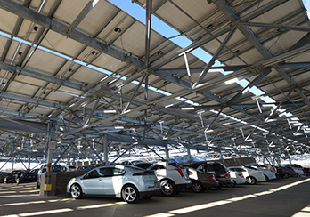 Cars parked in parking garage powered by solar energy