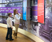 Students looking at posters/info boards in an exhibit