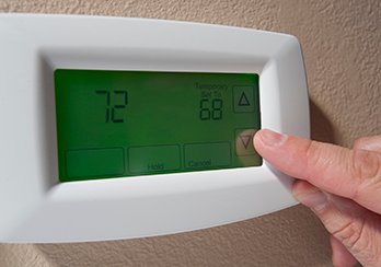 Finger touching pad of adjustable thermostat