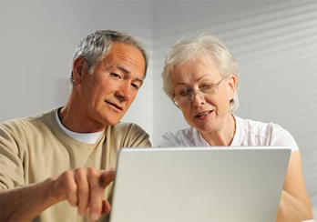 Older couple looking at a laptop computer screen