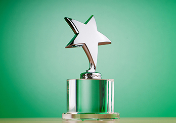 A green trophy with a gold star on top