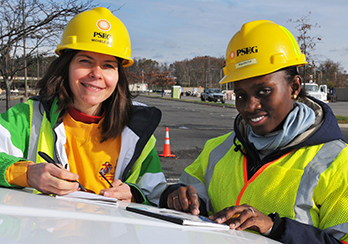 Two female workers in hard hats