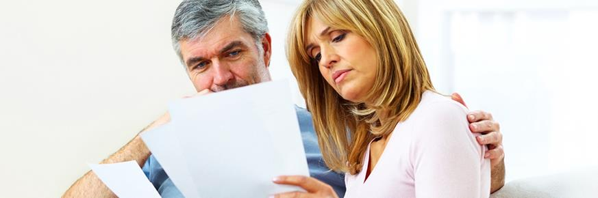 A couple looking at paperwork together