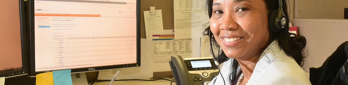 A customer service representative wearing a phone headset