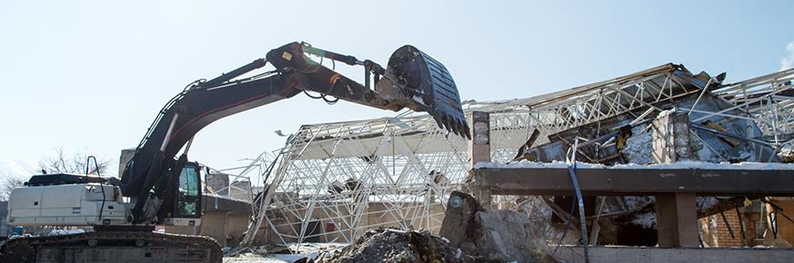 Large construction machine scooping debris