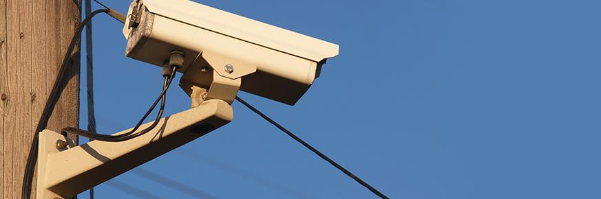 Security camera mounted on a utility pole