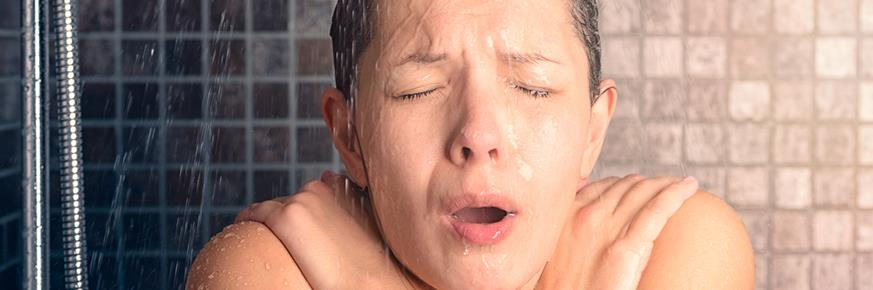 Woman in the shower looking very cold